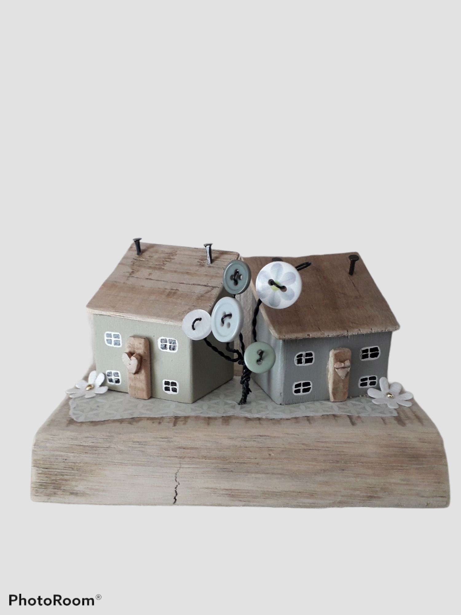 Two Wooden Houses With Wire And Button Tree